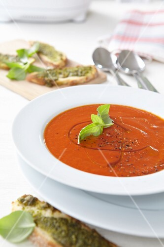 Tomato soup with olive oil and basil