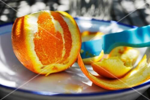 An orange, partly peeled