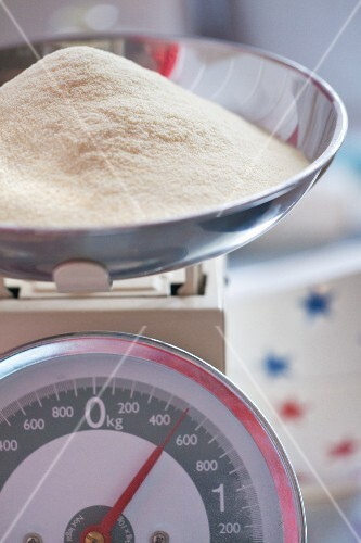 A mound of flour on a set of kitchen scales