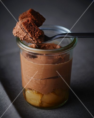 Mousse au chocolate with pears served in a jar