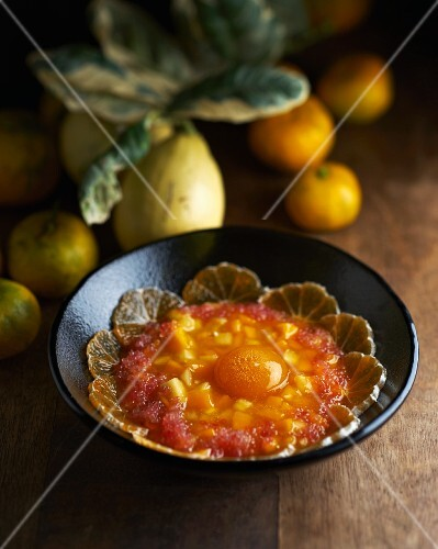 Exotic fruit salad with an egg yolk