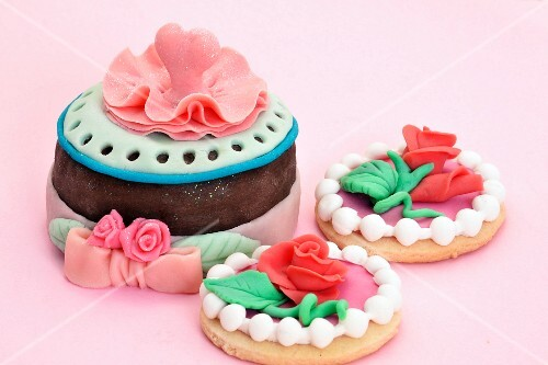 Cakes and biscuits decorated with marzipan roses
