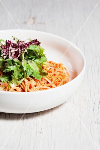 A salad of raw vegetables with carrots and red cabbage