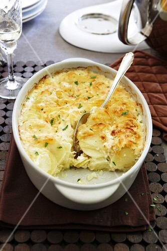Potato bake with cheese in the baking dish