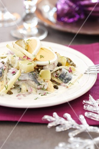 Herring salad with potatoes and eggs for Christmas