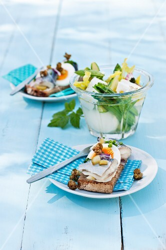 Smorrebrod topped with herring fillets and egg (Scandinavia)