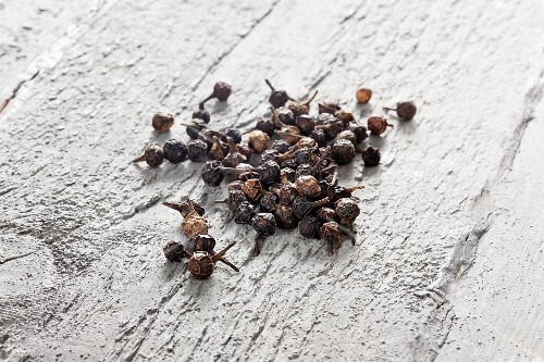 Cubeb (tailed pepper) on grey wood