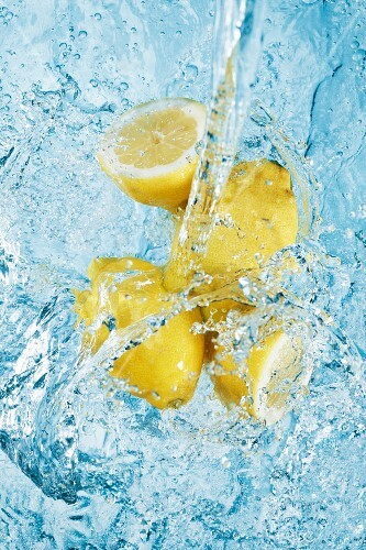 Water being poured over lemons