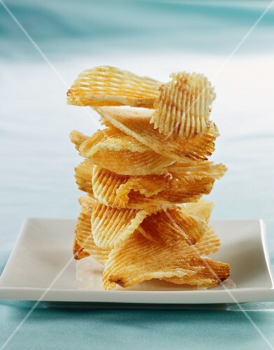Potato Chips Stacked on a White Plate