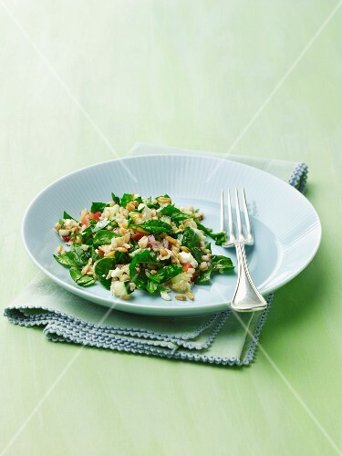 Kamut, Farro and Brown Rice Salad with Spinach on a Plate