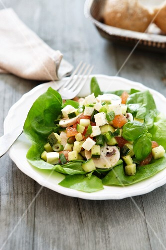 Courgette salad with cheese and sausage