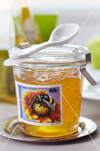 Jar of jam decorated with postage stamp