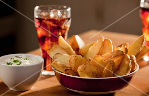 Potato wedges with a dip and a soft drink