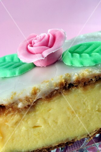 Custard slice decorated with a sugar flower (close-up)