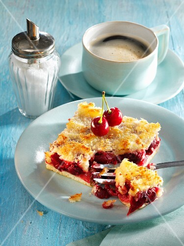 Tray-baked coconut cake with cherries