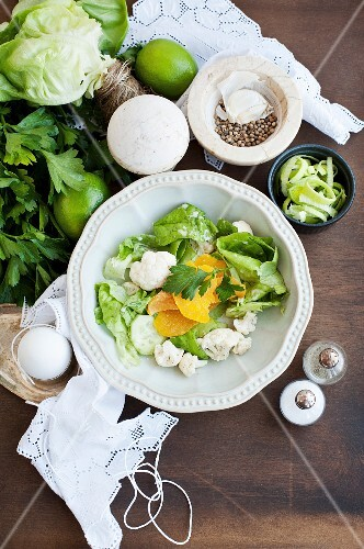 Salad with cauliflower, lettuce and apricots (view from above)