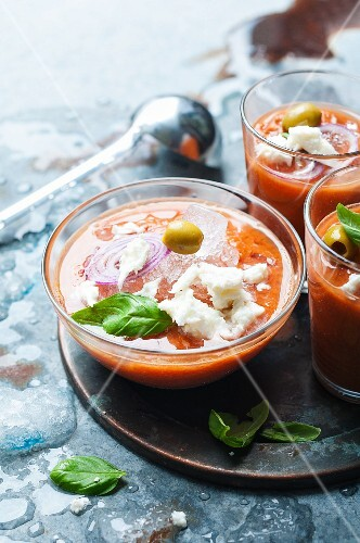 Cold tomato soup with mozzarella and olives