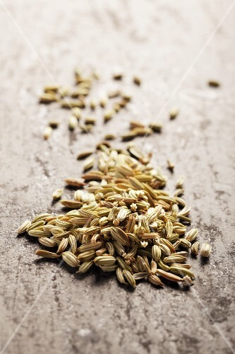Fennel seeds on a grey surface