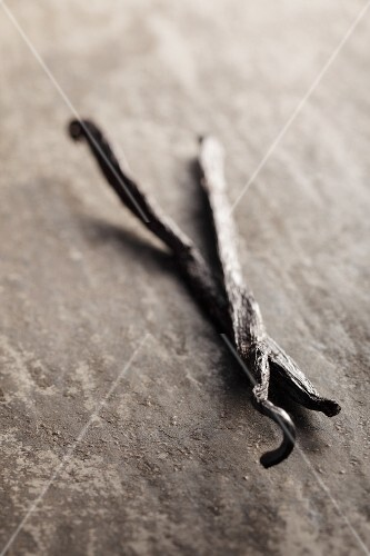 Vanilla pods on a grey surface