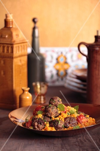 Koftas (Turkish meatballs) with a lentil and tomato medley
