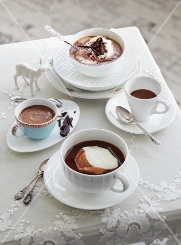 Four cups of drinking chocolate, with and without whipped cream