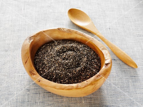 Chia seeds in a natural wood bowl