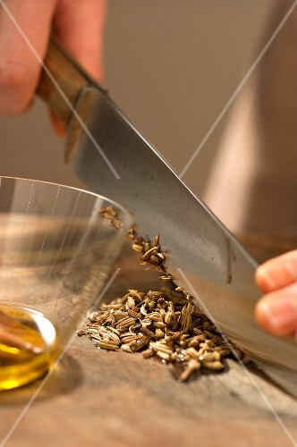 Caraway seeds being chopped