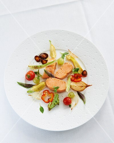 Salmon in a salt crust, sliced and served with grilled vegetables