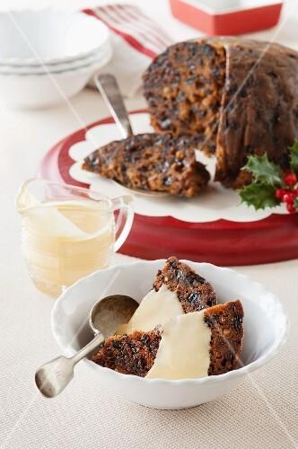 Christmas pudding with custard (England)