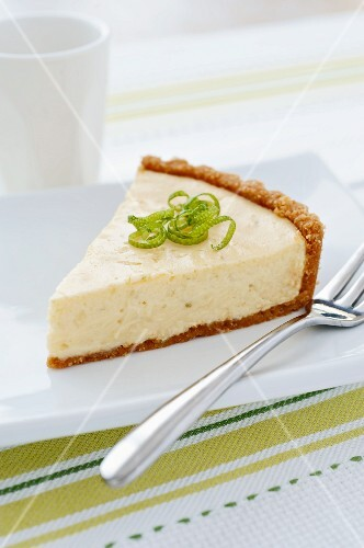Slice of Key Lime Pie on a White Plate with a Fork