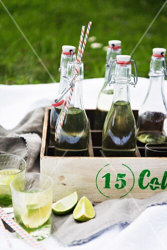 Home-made lemonade in stoppered bottles in a wooden bottle crate
