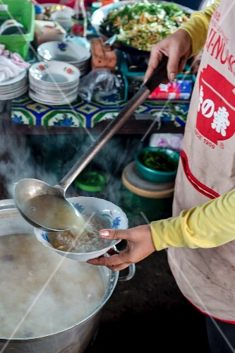 Rice soup is served in a street kitchen in Cambodia