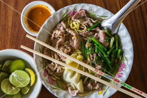 Pork noodle soup with limes and dipping sauce, Battambang, Cambodia