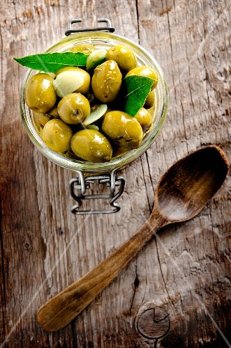 Preserved olives on a wooden surface