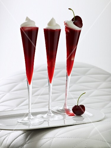 Sweet cherry jelly topped with whipped cream