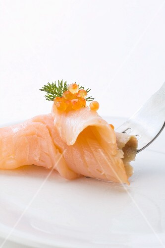 Smoked salmon topped with caviar, on a fork