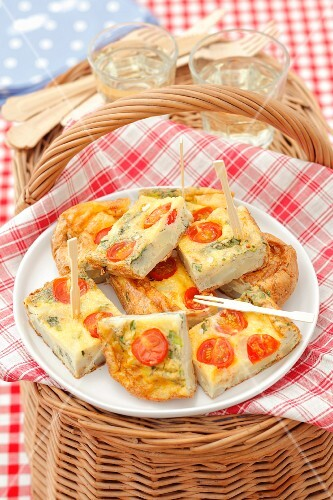 Potato tortilla with cherry tomatoes and green onion