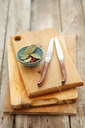 Wooden boards, knives and a small dish of spices