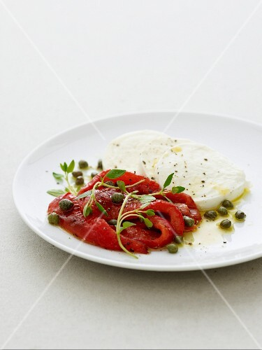 Grilled red pepper with sliced mozzarella, dressed with capers, oil and blackpepper