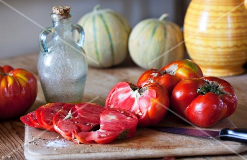 Oxheart tomatoes, one partly sliced