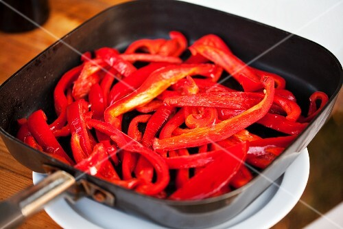 Sliced red peppers in a pan
