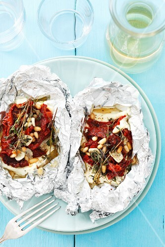 Feta with dried tomatoes, garlic and thyme grilled in foil