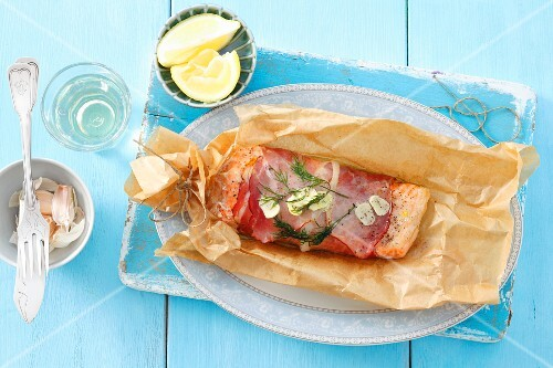 Salmon trout wrapped in prosciutto baked in parchment