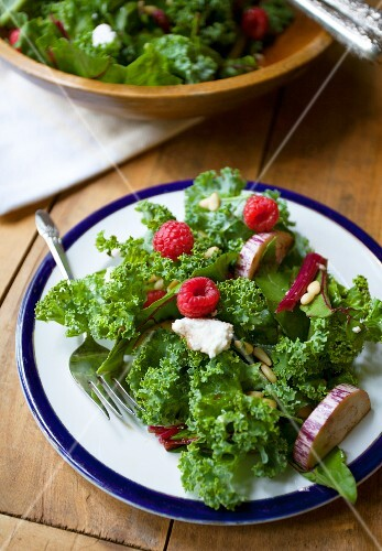 Lollo biondo lettuce with aubergines, raspberries and pine nuts