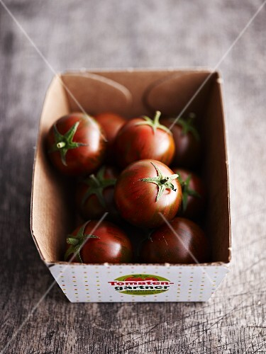 Mini tomatoes in a cardboard box