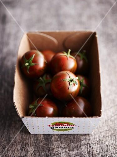 Mini tomatoes in a cardboard box