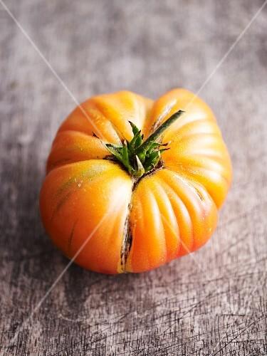A yellow beefsteak tomato