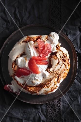 Caramel pavlova with vanilla-rum cream and marinated grapefruit