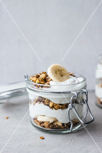 Cereal grains with yoghurt parfait and banana