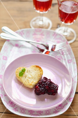 An omelette and a serving of cranberry jam, both in the shape of hearts